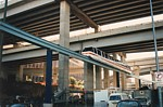 Monorail train next to goods line under expressway at rear of Darling Harbour thumbnail