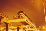 Monorail train on Maintenance Facility Through Traverser at night thumbnail