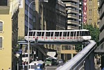 Monorail train with advertising crossing sides in Market Street thumbnail